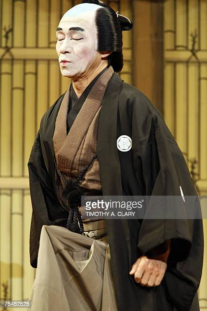 Sansano Takashi in the role of Kanjuro makes a face as he tries to contain an erection as part of the skit during the dress rehearsal for Heisei...