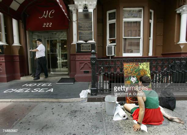 Susan Olmetti paints on the sidewalk in front of the Hotel Chelsea in New York City 25 June 2007 Chelsea Hotel manager Stanley Bard who has been a...