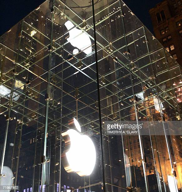 The Apple logo is reflected in the window panes of the new Apple store on Fifth Avenue in New York City 25 September 2006 The Apple store Fifth...