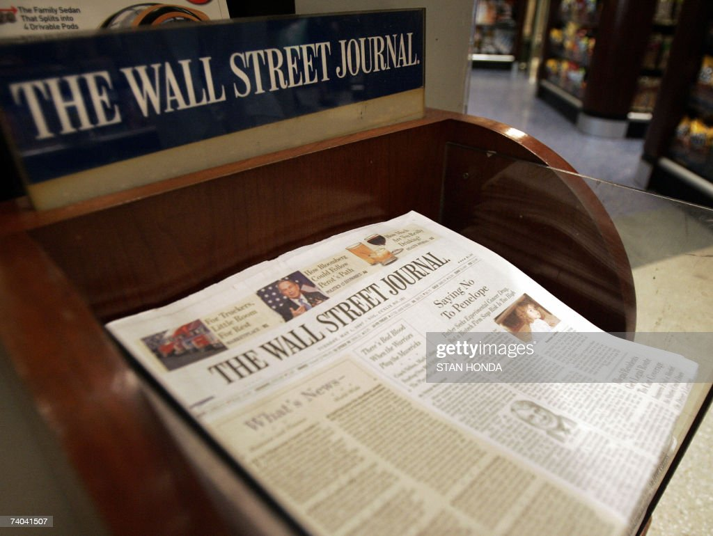 The Wall Street Journal is shown on sale at Hudson News, 01 May 2007, in Grand Central Terminal in New York. Rupert Murdoch's media group News Corp. launched a takeover bid Tuesday for US publishing firm Dow Jones, which owns the prominent Wall Street Journal business daily, the two companies said. News Corp. said in a statement it made 'a friendly offer' to acquire all of the outstanding shares of Dow Jones for 60 dollars each in cash, or in a combination of cash and News Corp. stock. Dow Jones described the action as 'an unsolicited proposal' and said it would study the offer. AFP PHOTO/Stan HONDA