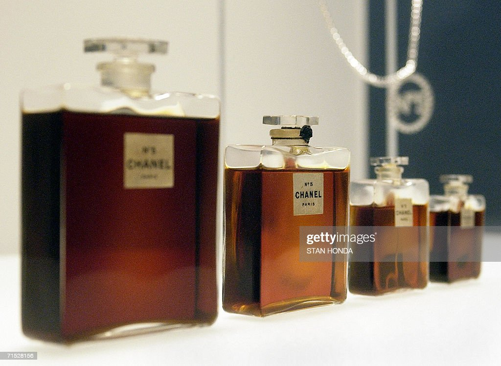 This 02 May 2005 file photo shows four bottles of Chanel No. 5 perfume by Gabrielle Chanel from 1921, and a Chanel No. 5 necklace (R, rear) during a press preview of 'Chanel', an exhibition of the history of the fashion House of Chanel at the Metropolitan Museum of Art in New York. The US Congress reviewed testimony 27 July 2006 in Washington on whether to issue intellectual property rights to fashion houses and their creations. AFP PHOTO/FILES/Stan HONDA