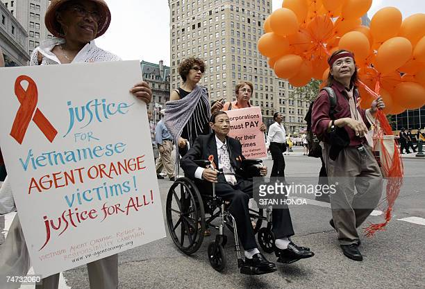 TO GO WITH AFP STORY BY CATHERINE HOURS 'USVIETNAMWARHEALTHWEAPONS' Nguyen Van Quy a Vietnamese vicitim of Agent Orange and others make their way to...
