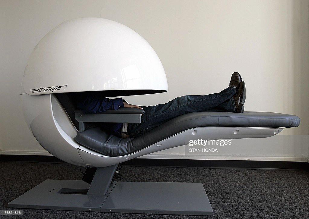 TO WITH AFP STORY USSOCIETYHEALTHCOMPANIES Metronaps CEO Arshad Chowdhury demostrates a prototype sleeping 'pod' with a retractable shield that...