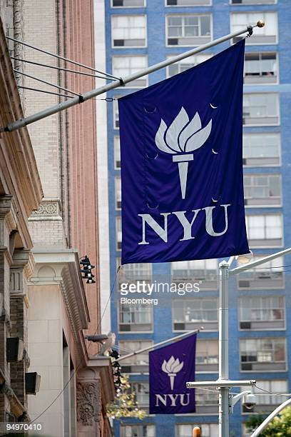 New York University flags hang outside buildings in New York US on Tuesday July 28 2009 Millions of dollars for financial aid is out of reach at New...