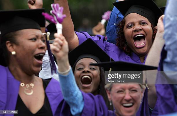 New York University graduates celebrate during commencement ceremonies in Washington Square Park May 10 2007 in New York City The event was NYU's...