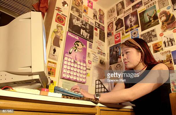 New York University student Jennifer Huang downloads music from the Napster site March 6 2001 in New York City A federal judge has ordered Napster...