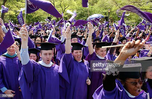New York University students cheer near the conclusion of commencement exercises May 15 2003 in New York City Recipients of honorary degrees included...