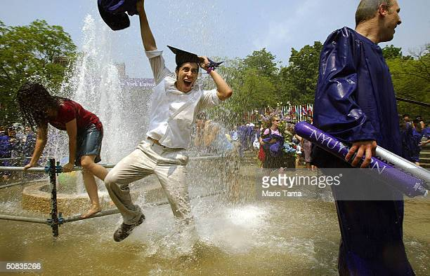 New York University students dance in the fountain during graduation ceremonies in Washington Square Park May 13 2004 in New York City Over 15000...