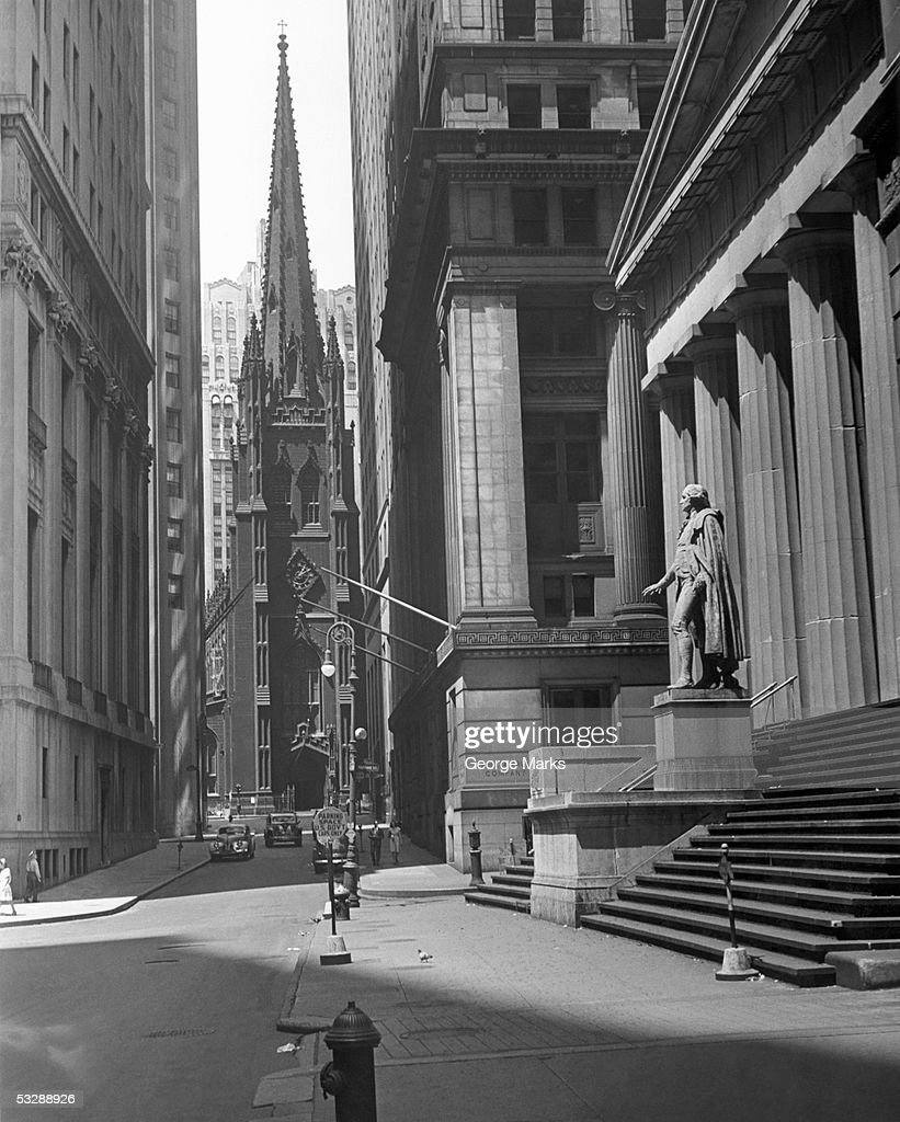 New York. View up Wall St. of Trinity Ch : Stock Photo