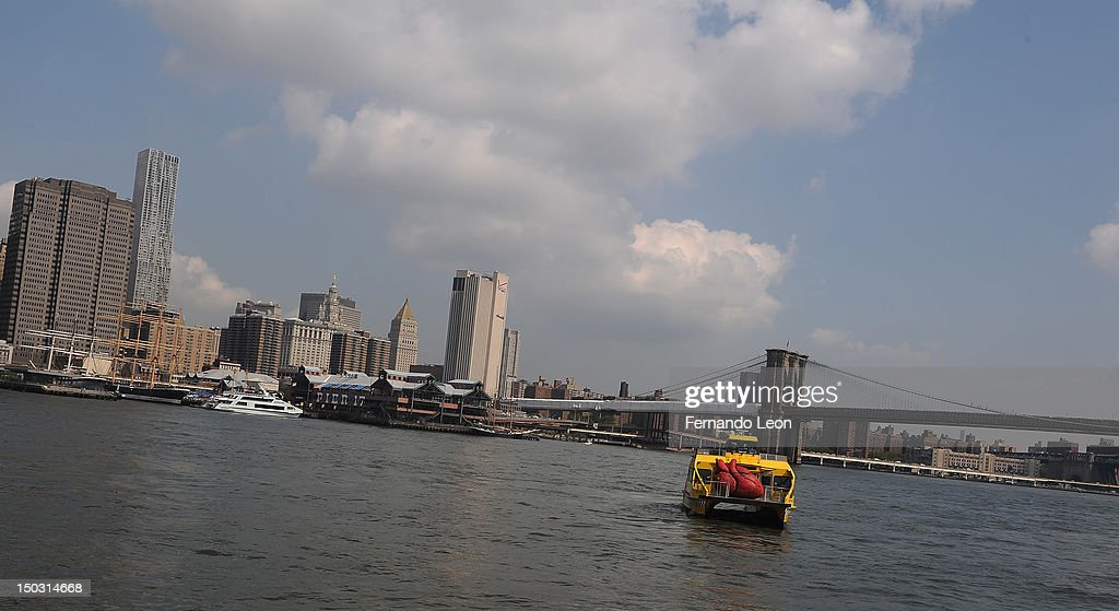 A New York Water Taxi carries a Huge Heart Statue to it's unveiling at 'Bodies...The Exhibition' at South Street Seaport on August 15, 2012 in New York City.