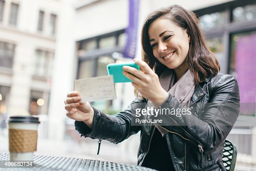 New York Woman Depositing Check Remotely