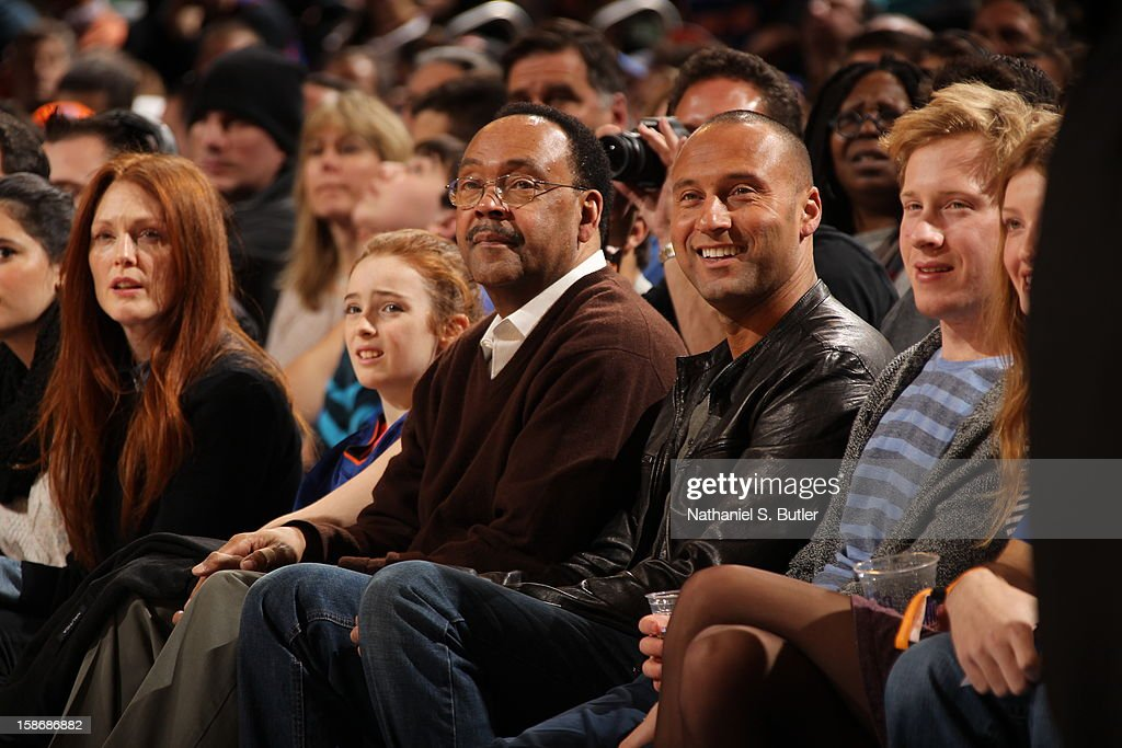 New York Yankee captain Derek Jeter (R) and His father Dr. Sanderson Charles Jeter (L) look on at a game played between the Minnesota Timberwolves and New York Knicks on December 23, 2012 at Madison Square Garden in New York City.