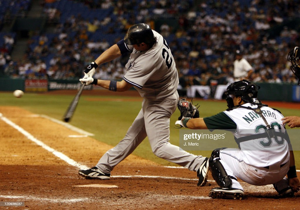 New York Yankee Jason Giambi gets into this pitch during Friday night's game between the Yankees and Devil Rays at Tropicana Field in St Petersburg...