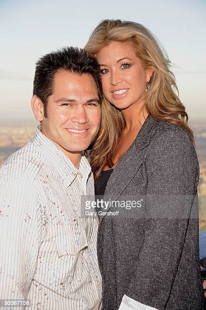 New York Yankee Johnny Damon and wife Michelle ManganDamon pose for pictures on the uppermost level of The Empire State Building in celebration of...