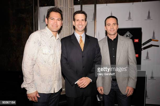 New York Yankee Johnny Damon New York City Commissioner of Sports Kenneth J Podziba and NASCAR championship driver Jimmie Johnson pose for pictures...