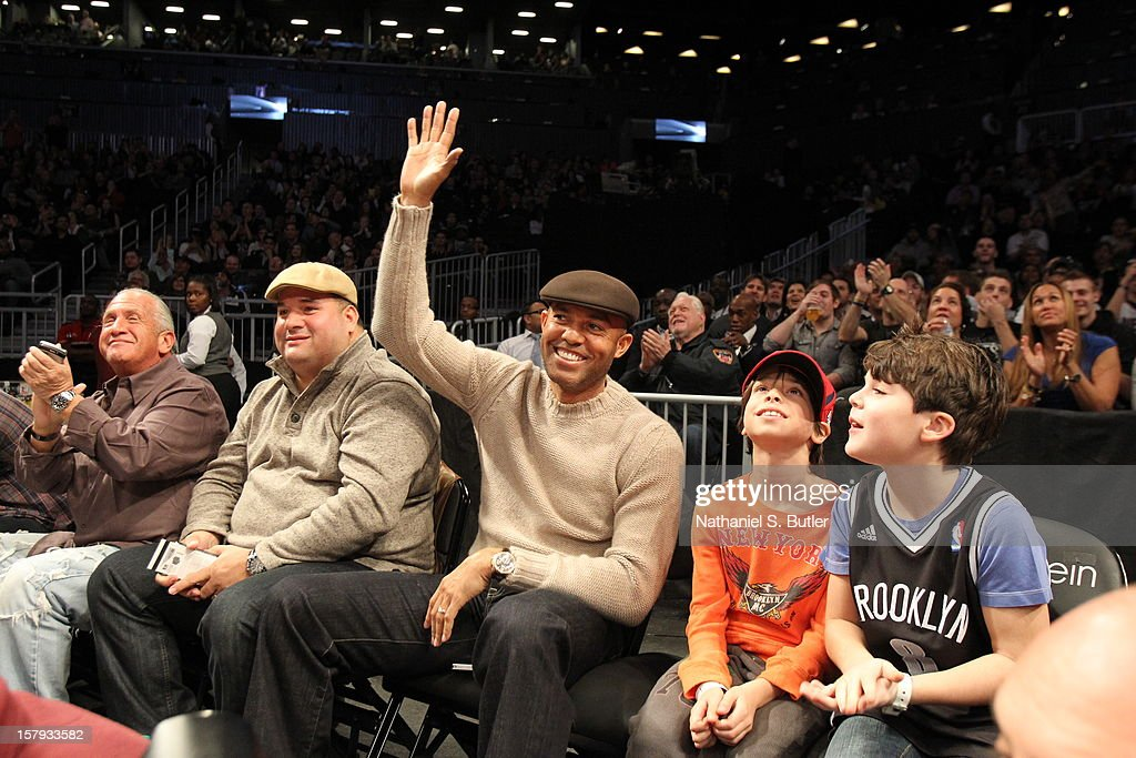 New York Yankee Mariano Rivera waves to the crowd during the Brooklyn Nets and the Golden State Warriors game on December 7, 2012 at the Barclays Center in the Brooklyn Borough of New York City.