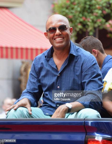 New York Yankee pitcher Mariano Rivera waves to fans as he passes by during the MLB AllStar Game Red Carpet Show on July 16 2013 in New York City