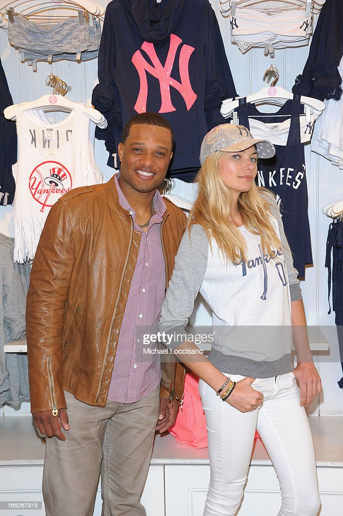 New York Yankee <a gi-track='captionPersonalityLinkClicked' href=/galleries/search?phrase=Robinson+Cano&family=editorial&specificpeople=538362 ng-click='$event.stopPropagation()'>Robinson Cano</a> and model <a gi-track='captionPersonalityLinkClicked' href=/galleries/search?phrase=Jessica+Hart&family=editorial&specificpeople=4436555 ng-click='$event.stopPropagation()'>Jessica Hart</a> celebrate the launch of the Victoria's Secret PINK MLB Collection at Victoria Secret Soho on April 2, 2013 in New York City.