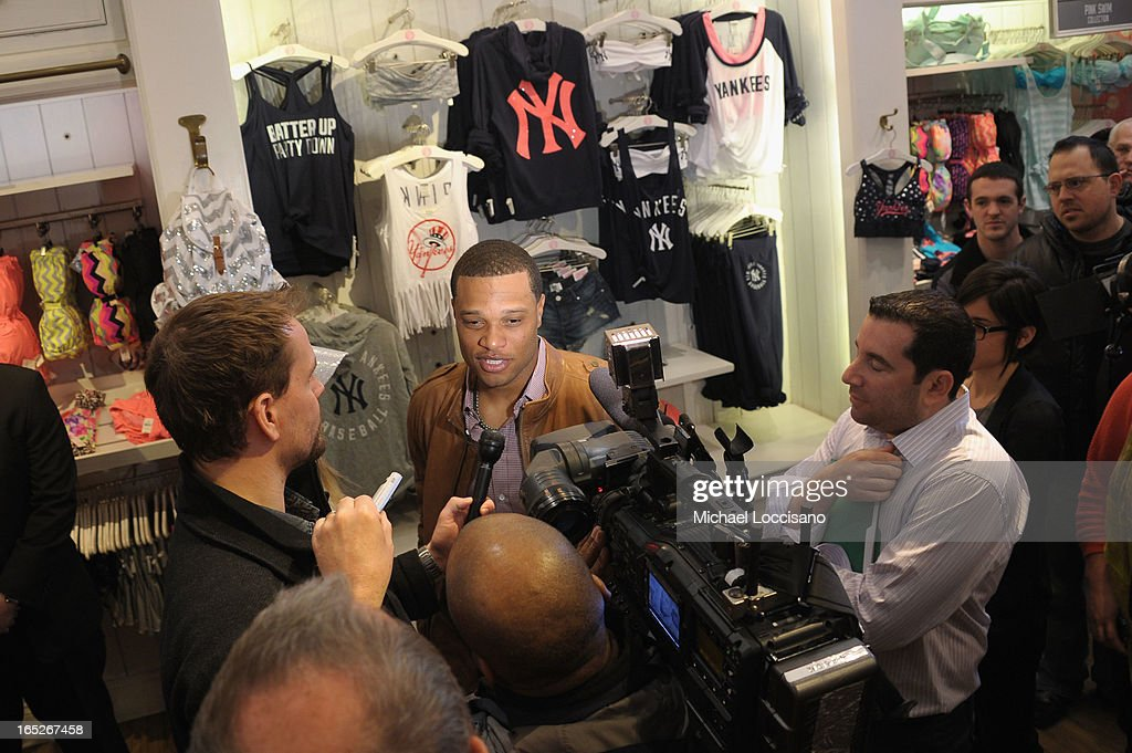 New York Yankee <a gi-track='captionPersonalityLinkClicked' href=/galleries/search?phrase=Robinson+Cano&family=editorial&specificpeople=538362 ng-click='$event.stopPropagation()'>Robinson Cano</a> celebrates the launch of the Victoria's Secret PINK MLB Collection at Victoria Secret Soho on April 2, 2013 in New York City.
