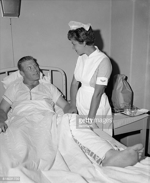 New York Yankee slugger Mickey Mantle is shown in Lenox Hill Hospital with student nurse Barbara Boch of Little Neck Long Island Mantle's bandaged...