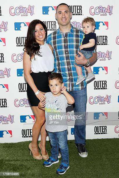 New York Yankee Travis Hafner his wife Amy Hafner and their children attend the CCandy Children's Clothing Line Launch at MLB Fan Cave on August 8...