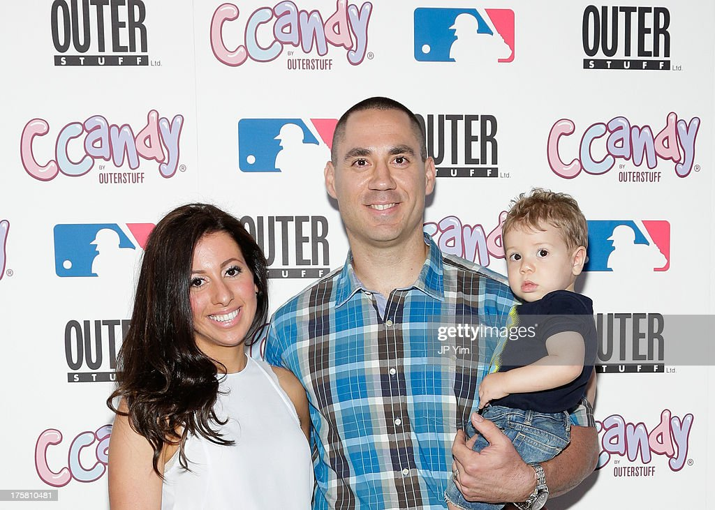 New York Yankee Travis Hafner his wife Amy Hafner and their son attend the CCandy Children's Clothing Line Launch at MLB Fan Cave on August 8 2013 in...