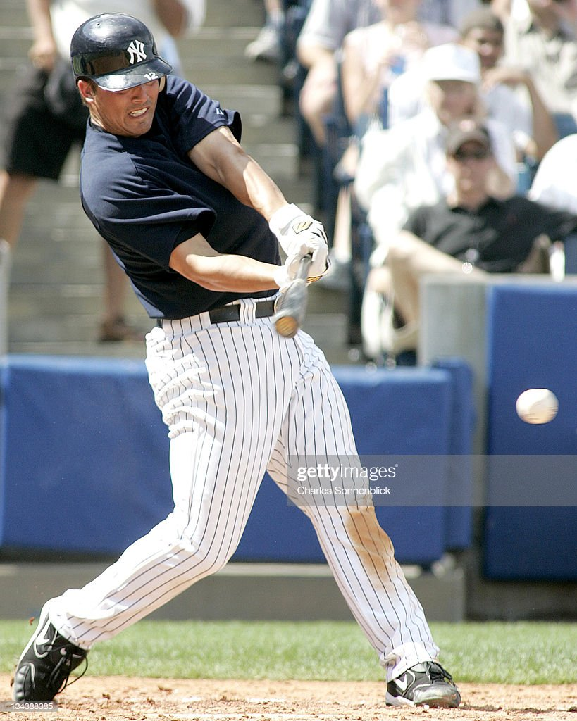New York Yankees 1st baseman Andy Phillips hits a line drive in a spring training game against the Atlanta Braves Saturday March 11 2006 at Legends...