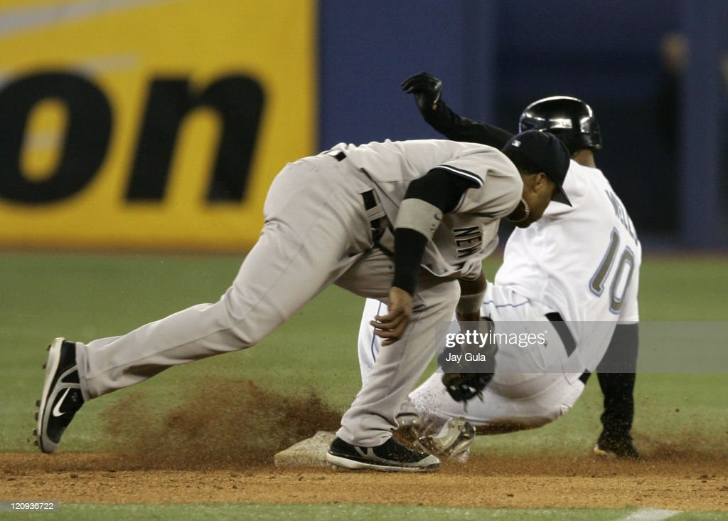 New York Yankees 2B Robinson Cano is too late with the tag to get Toronto's Vernon Wells who was safe at 2nd base with a stolen base in action at...