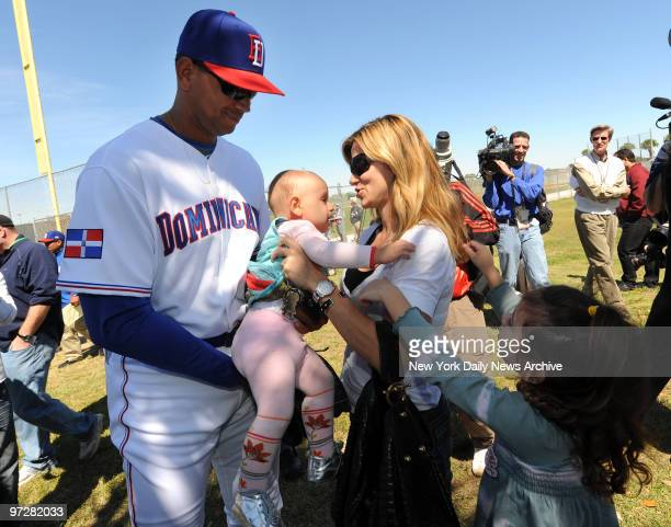 New York Yankees Alex Rodriguez passes his daughter Ella to his exwife Cynthia while daughter Natasha reaches outThe Dominican Republic baseball team...