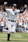 New York Yankees' Alex Rodriguez throws his fists in the air as he starts his home run trot after hitting his 500th career homer in the first inning...