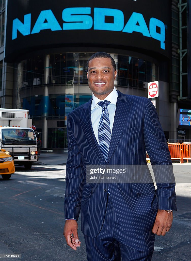 New York Yankees All-Star Robinson Cano poses outside NASDAQ as he attends to ring the opening bell at NASDAQ MarketSite on July 15, 2013 in New York City.