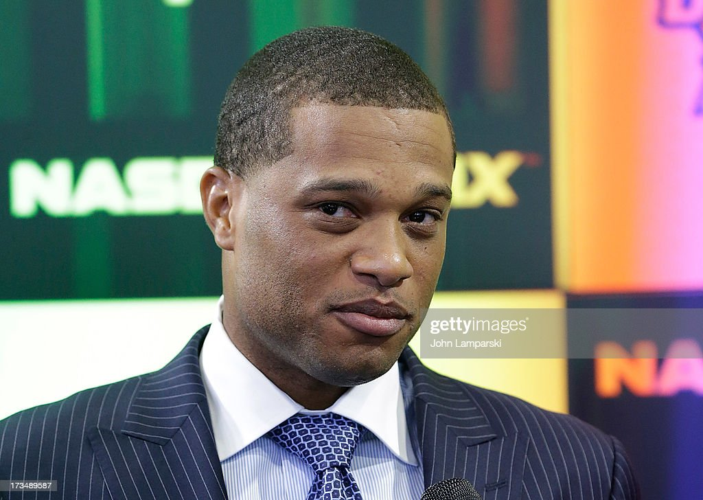 New York Yankees All-Star <a gi-track='captionPersonalityLinkClicked' href=/galleries/search?phrase=Robinson+Cano&family=editorial&specificpeople=538362 ng-click='$event.stopPropagation()'>Robinson Cano</a> rings the opening bell at NASDAQ MarketSite on July 15, 2013 in New York City.