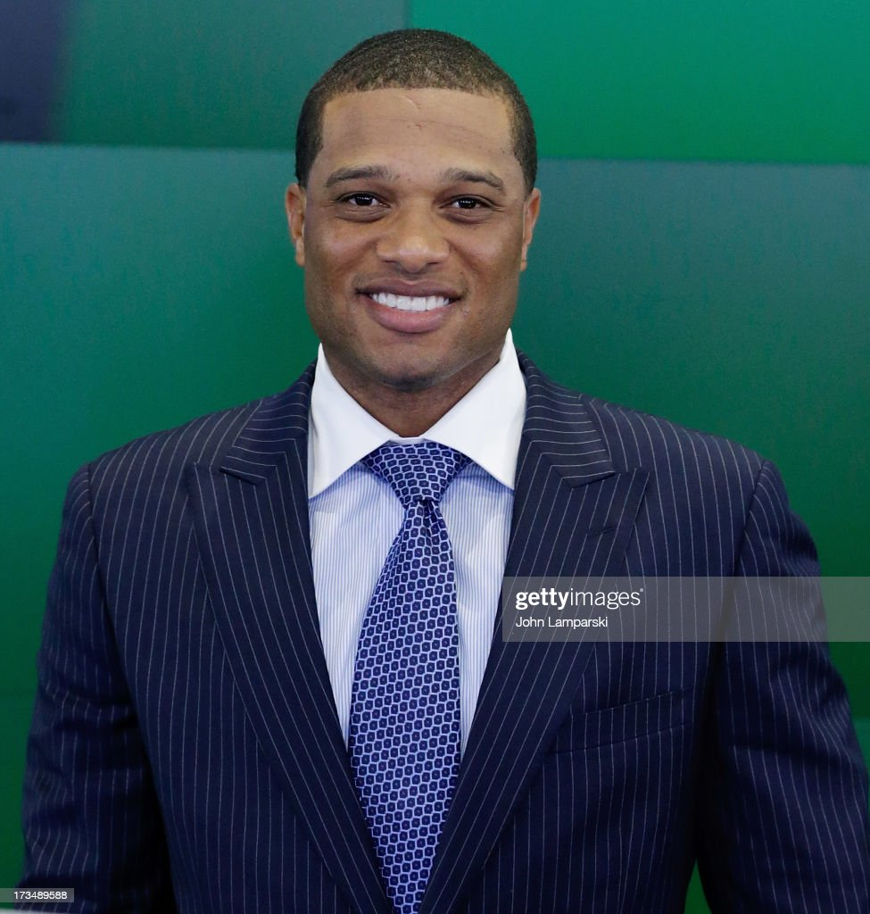 New York Yankees All-Star Robinson Cano rings the opening bell at NASDAQ MarketSite on July 15, 2013 in New York City.