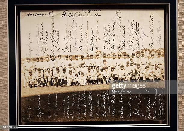 New York Yankees autographed team photo is seen at a Sotheby's preview of a baseball memorabilia sale titled 'The Babe Comes Home' November 23 2004...