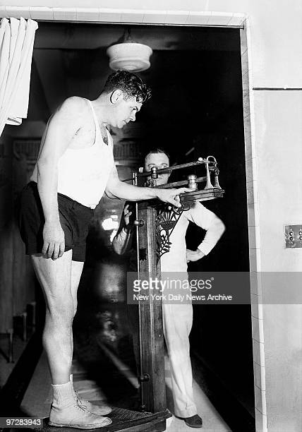 New York Yankees' Babe Ruth being weighed during training