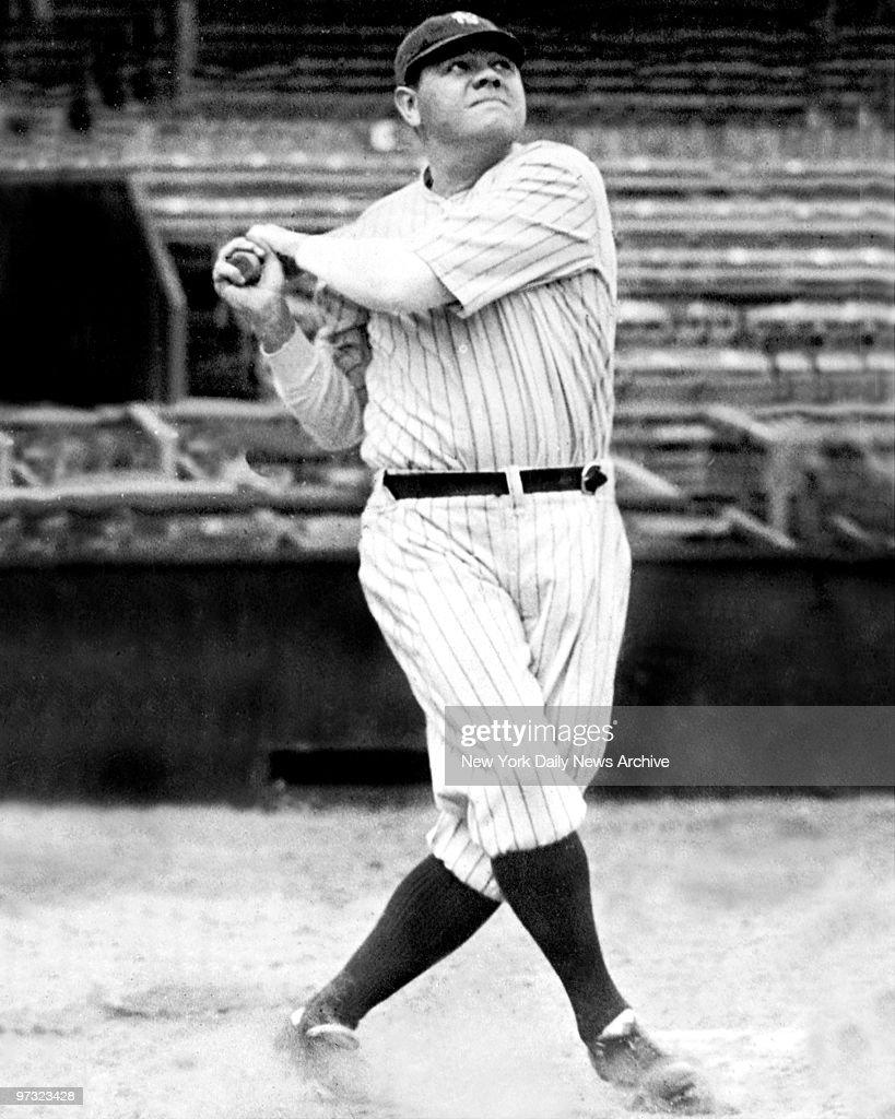 New York Yankees' Babe Ruth swinging his bat Babe Ruth follows flight of one of his 46 home runs Ruth's recordsetting swats kept Yankee Stadium full...