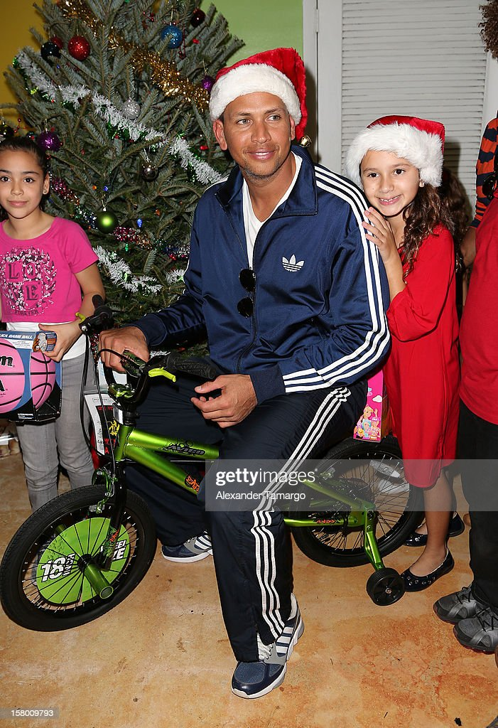New York Yankees baseball player Alex Rodriguez and his daughter Natasha Rodriguez help deliver toys at Boys and Girls Club Of Miami-Dade on December 8, 2012 in Miami, Florida.