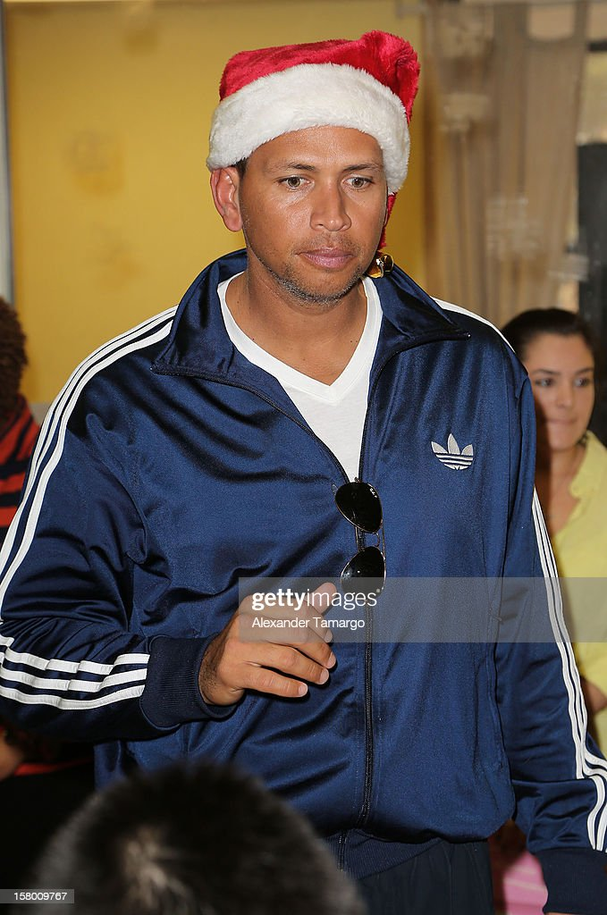 New York Yankees baseball player <a gi-track='captionPersonalityLinkClicked' href=/galleries/search?phrase=Alex+Rodriguez&family=editorial&specificpeople=167080 ng-click='$event.stopPropagation()'>Alex Rodriguez</a> helps deliver toys at Boys and Girls Club Of Miami-Dade on December 8, 2012 in Miami, Florida.