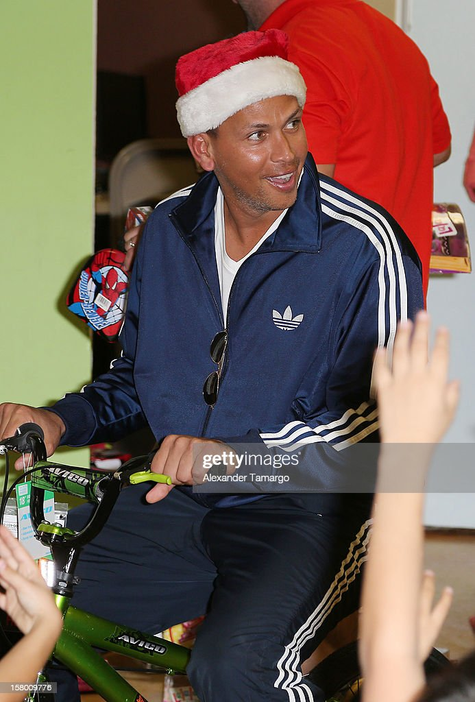 New York Yankees baseball player Alex Rodriguez helps deliver toys at Boys and Girls Club Of Miami-Dade on December 8, 2012 in Miami, Florida.