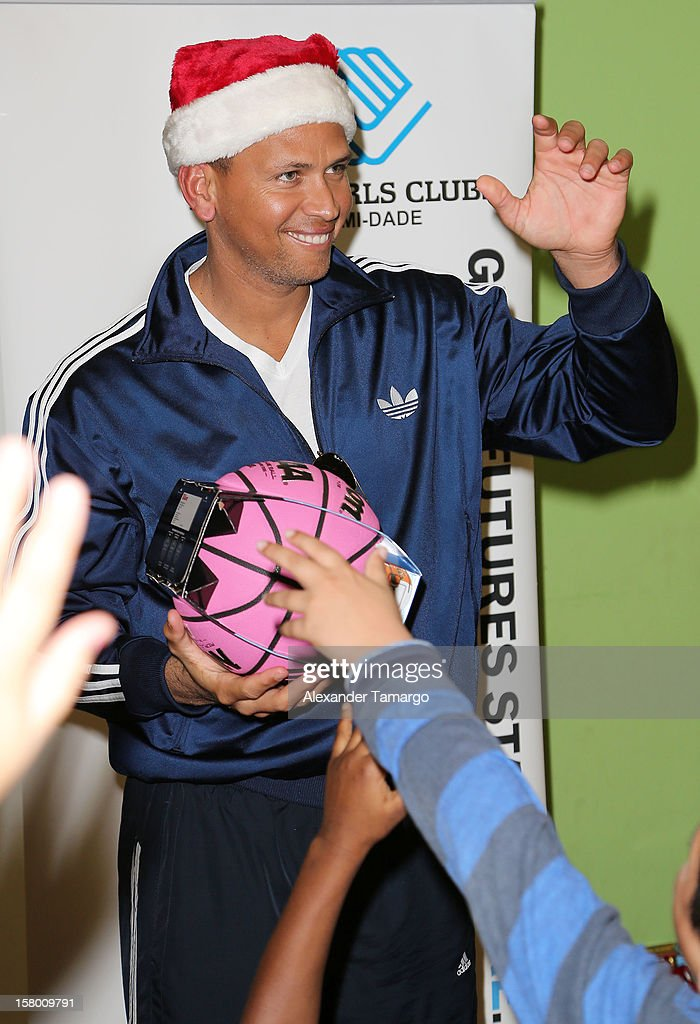 New York Yankees baseball player <a gi-track='captionPersonalityLinkClicked' href=/galleries/search?phrase=Alex+Rodriguez+-+Basebollspelare&family=editorial&specificpeople=167080 ng-click='$event.stopPropagation()'>Alex Rodriguez</a> helps deliver toys at Boys and Girls Club Of Miami-Dade on December 8, 2012 in Miami, Florida.