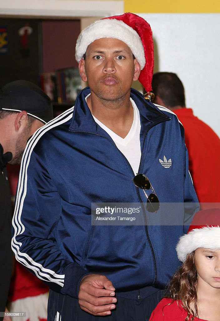 New York Yankees baseball player <a gi-track='captionPersonalityLinkClicked' href=/galleries/search?phrase=Alex+Rodriguez+-+Honkballer&family=editorial&specificpeople=167080 ng-click='$event.stopPropagation()'>Alex Rodriguez</a> helps deliver toys at Boys and Girls Club Of Miami-Dade on December 8, 2012 in Miami, Florida.