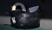 New York Yankees batting helmet sits in the dugout before a game with the Cleveland Indians on July 5 2011 at Progressive Field in Cleveland Ohio New...