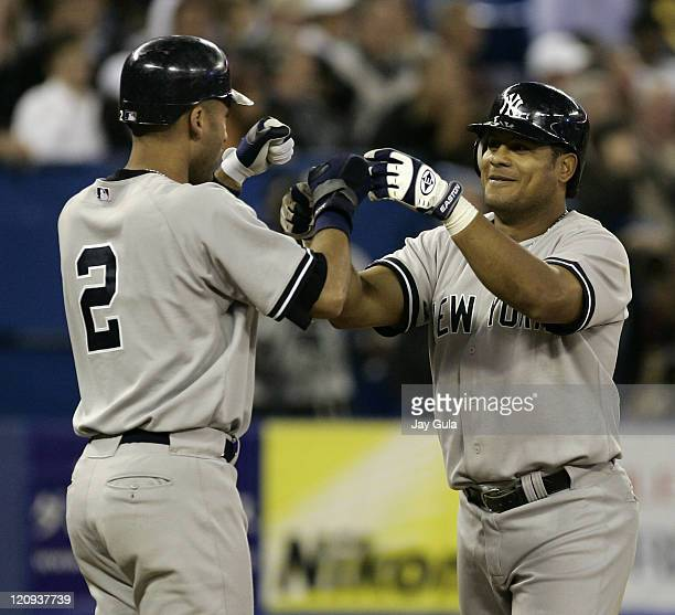 New York Yankees Bobby Abreu is congratulated by Derek Jeter after hitting his 4th HR as a Yankee vs the Toronto Blue Jays at Rogers Centre in...