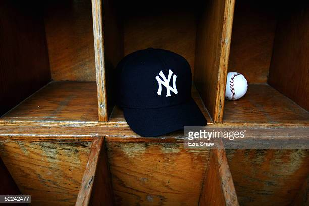 New York Yankees cap and a baseball are seen at Legends Field on February 25 2005 in Tampa Florida