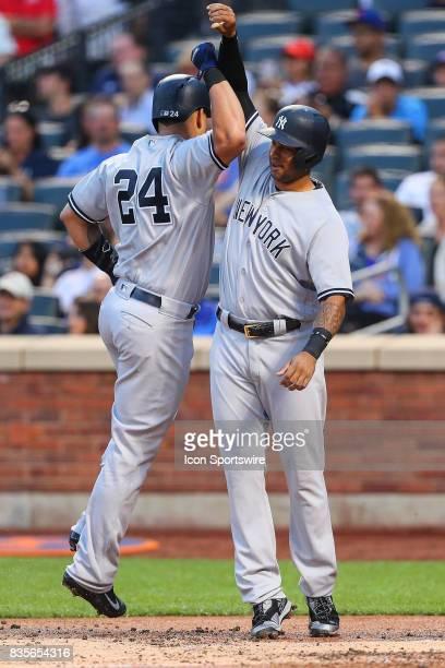 New York Yankees catcher Gary Sanchez high fives New York Yankees center fielder Aaron Hicks 31 after he hits a three run homerun during the first...
