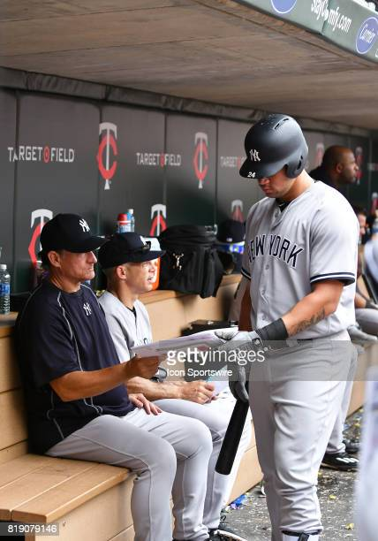 New York Yankees Catcher Gary Sanchez looks at pitching charts with a bench coach during a MLB game between the Minnesota Twins and New York Yankees...