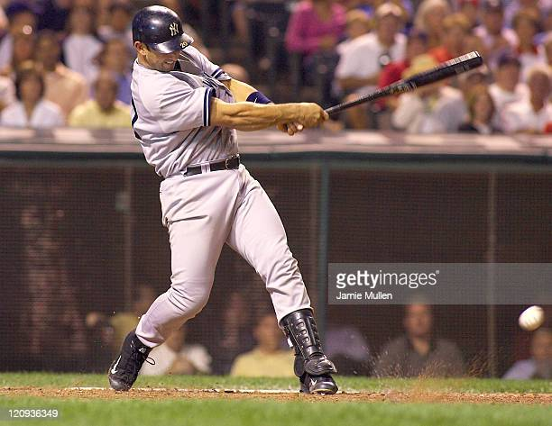 New York Yankees' catcher Jorge Posada bats during the game against the Cleveland Indians Monday August 23 2004 in Jacobs Field in Cleveland Ohio The...