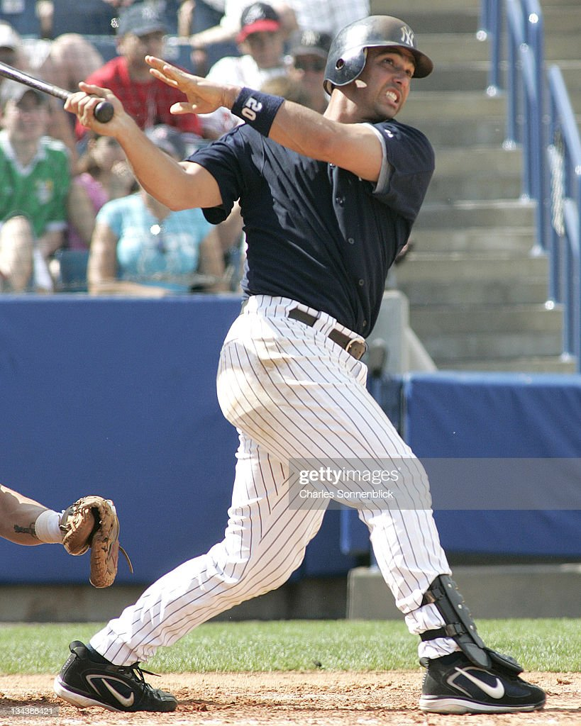 New York Yankees catcher Jorge Posada connects for a grand slam in a spring training game against the Atlanta Braves Saturday March 11 2006 at...