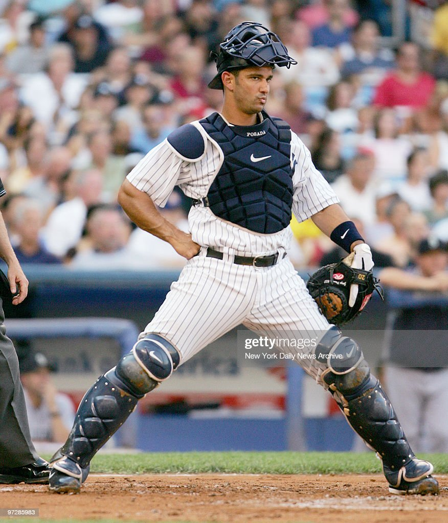 New York Yankees catcher Jorge Posada stares over to first
