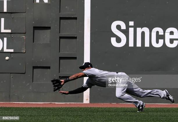 New York Yankees center fielder Aaron Hicks makes a diving catch to rob Boston Red Sox first baseman Mitch Moreland in the second inning The Boston...
